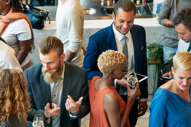 diverse-business-people-dinner-party